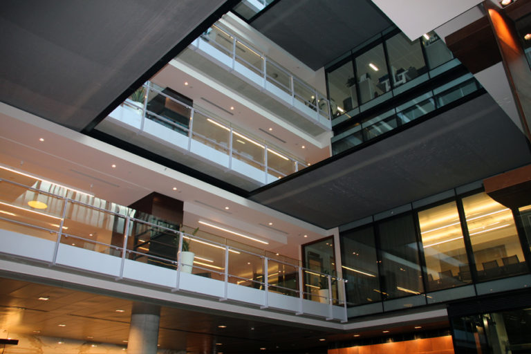 Coopers Fire FireMaster NVS Horizontal fire curtain protecting an atrium from fire in an office