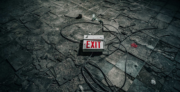 Old exit sign on floor