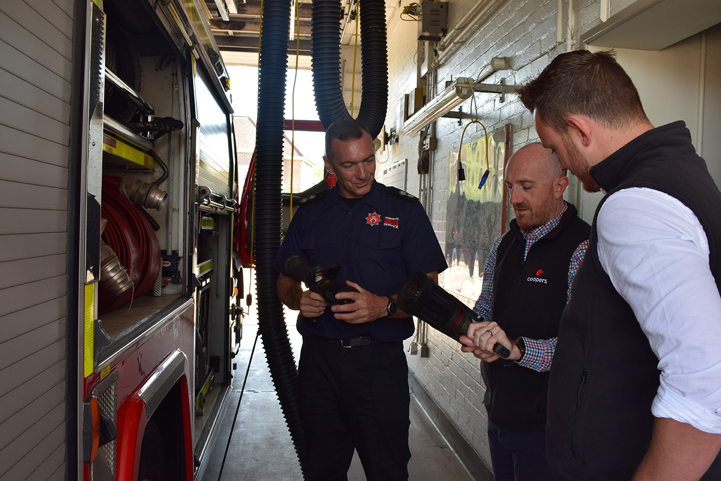 Coopers Fire Sat Havant fire station looking at different fire fighting equipment