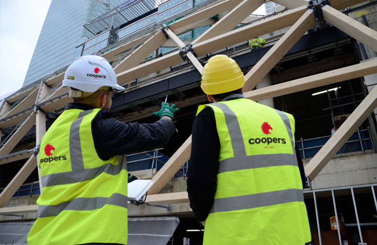 Coopers Fire contractors in high vis jackets on site