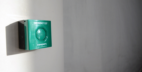 Green emergency exit button at Coopers Fire HQ