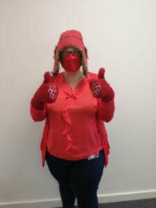 Staff wearing all red including mask, hat and gloves